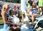 02 September 2006: Two UNC cheerleaders escort the bell onto the field. The University of North Carolina Tarheels lost 21-16 to the Rutgers Scarlett Knights at Kenan Stadium in Chapel Hill, North Carolina in an NCAA Division I College Football game.