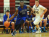 Andre Morgan #13 of Copiague, left, looks to get inside the paint during a Suffolk County varsity boys' basketball game against host Whitman High School on Tuesday, Dec. 15, 2015. He scored 16 points in Copiague's 54-34 win.
