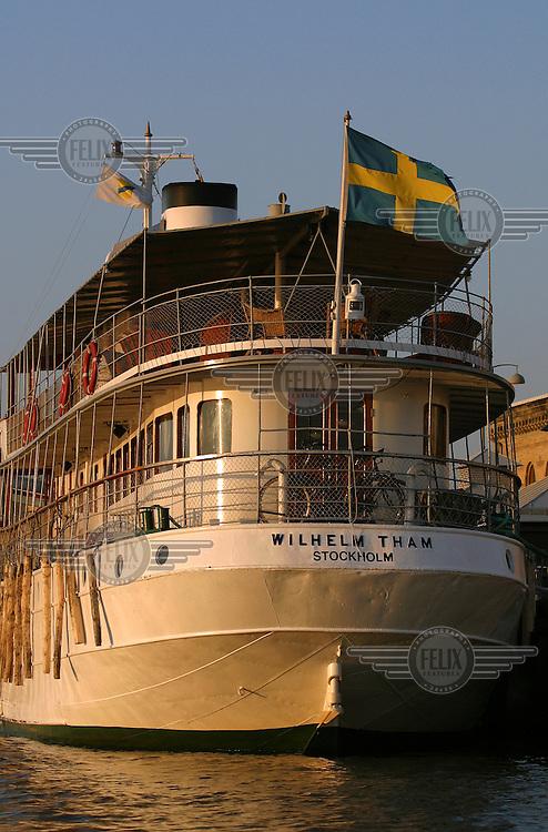 Historic boat with Swedish flag.