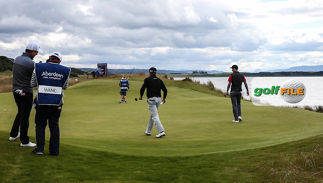 Action on the 11th green during Round Two of the 2016 Aberdeen Asset Management Scottish Open, played at Castle Stuart Golf Club, Inverness, Scotland. 08/07/2016. Picture: David Lloyd   Golffile.<br /> <br /> All photos usage must carry mandatory copyright credit (&copy; Golffile   David Lloyd)