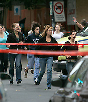 Students at the scene of a school shooting in Montreal Dawson College. <br /> Wenesday Sepetmber 13 2006<br /> <br /> Carrying an automatic rifle, two other guns, and dressed head to toe in black, the man stormed into the sprawling downtown Dawson College and began coldly cutting down students. Ninteen people were wounded, five critically, One dead.<br /> <br /> Several published reports identified the gunman as Kimveer Gill, 25, of Laval, north of Montreal. Police would not confirm the gunman's identity. <br /> Photo byYves Provencher/ Images Distribution