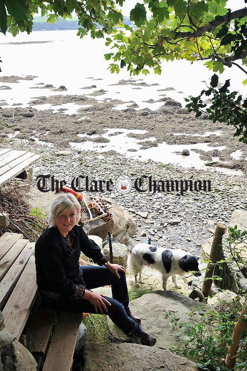 "Artist Trudy Van Der Elsen with her dog ""Ticker"". Photograph by John Kelly."