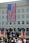 United States President Barack Obama, U.S. Secretary of Secretary Chuck Hagel, and Chairman of of the Joint Chiefs of Staff General Martin Dempsey pause during a moment of silence during a remembrance at the 12th anniversary commemoration of the 9/11 terrorist attacks at the Pentagon Memorial at the Pentagon in Washington, DC on September 11, 2013. Nearly 3,000 people were killed in the attacks in New York, Washington and Shanksville, Pennsylvania.  <br /> Credit: Pat Benic / Pool via CNP