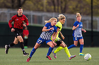 Allston, MA - Sunday, April 24, 2016: Referee Matthew Franz, Boston Breakers player McCall Zerboni (77), Seattle Reign FC midfielder Jessica Fishlock (10), Boston Breakers defender Kassey Kallman (5). The Boston Breakers play Seattle Reign during a regular season NSWL match at Harvard University.