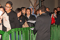 "Emahn, an Occupy Orange County protestor, hands out fliers reading ""Occupy"" to customers lined up early on the morning (1:25am) of Black Friday in front of a Best Buy in Costa Mesa, CA at South Coast Plaza."