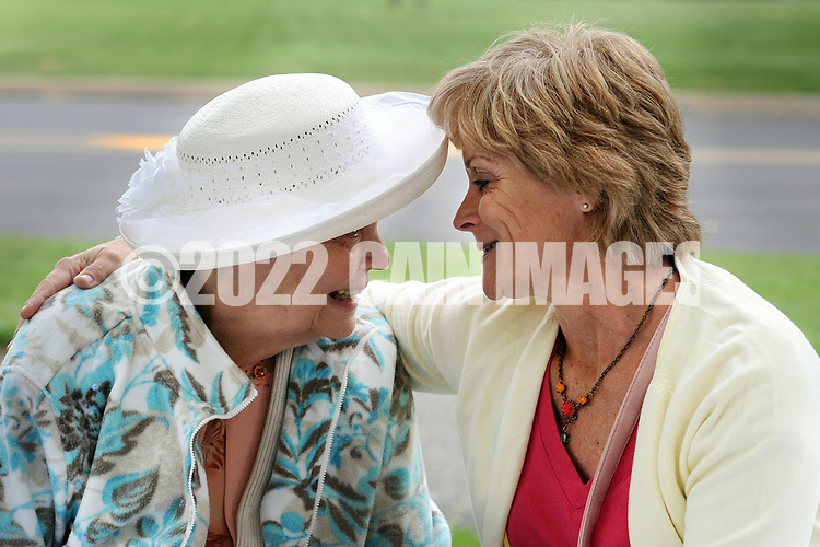 Elizabeth Marion (L) shares a moment with her daughter Marguerite Marnien of Levittown, Pennsylvania during a Mother's Day luncheon on the grounds of Spring Village at Floral Vale for their patients and their families Saturday May 9, 2015 in Yardley, Pennsylvania. (Photo by William Thomas Cain/Cain Images)