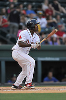 First baseman Josh Ockimey (18) of the Greenville Drive hits a home run in a game against the Columbia Fireflies on Thursday, April 21, 2016, at Fluor Field at the West End in Greenville, South Carolina. Columbia won, 13-9. (Tom Priddy/Four Seam Images)