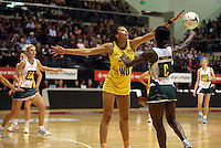 25.10.2012 Australia's Chanel Gomes and South Africa's Bongiwe Msomi in action during the England v Australia netball test match as part of the Quad Series played at the TSB Arena Wellington. Mandatory Photo Credit ©Michael Bradley.