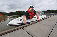 NWA Democrat-Gazette/J.T. WAMPLER Brain Doty of Bentonville ties off his boat to a cleat Friday May 26, 2017 after he and his wife Julie Doty motored around Beaver Lake at the Prairie Creek Recreation Area & Campground near Rogers. More Americans are expected to travel this holiday weekend since 2005 and Arkansas state park campgrounds were nearing capacity as of Friday afternoon.
