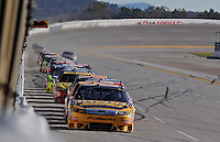 Nov. 1, 2009; Talladega, AL, USA; NASCAR Sprint Cup Series driver Jamie McMurray leads a pack of cars single file down the backstretch during the Amp Energy 500 at the Talladega Superspeedway. Mandatory Credit: Mark J. Rebilas-