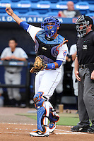 St. Lucie Mets catcher Francisco Pena #11 throws to third in front of umpire Brian Fields during a game against the Charlotte Stone Crabs at Digital Domain Ballpark on June 20, 2011 in Port St Lucie, Florida.  St. Lucie defeated Charlotte 3-2 in 11 innings.  (Mike Janes/Four Seam Images)