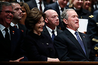 Former Florida Gov. Jeb Bush, Laura Bush and former President George W. Bush smile during a State Funeral for former President George H.W. Bush at the Washington National Cathedral, Wednesday, Dec. 5, 2018, in Washington. <br /> CAP/MPI/RS<br /> &copy;RS/MPI/Capital Pictures