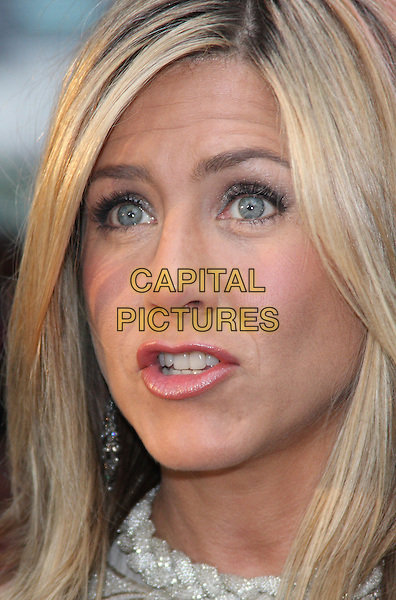 JENNIFER ANISTON.Horrible Bosses UK Premiere, BFI, London, England..20th July 2011.headshot portrait mouth open.CAP/WIZ.© Wizard/Capital Pictures.