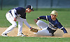Stephen Strategakos #22 of Baldwin, right, slides safely into second base as Nick Franco #3 of Plainview JFK tries to tag him in the top of the third inning of Nassau County varsity baseball game at Plainview JFK High School on Monday, May 8, 2017. Baldwin won by a score of 8-3.