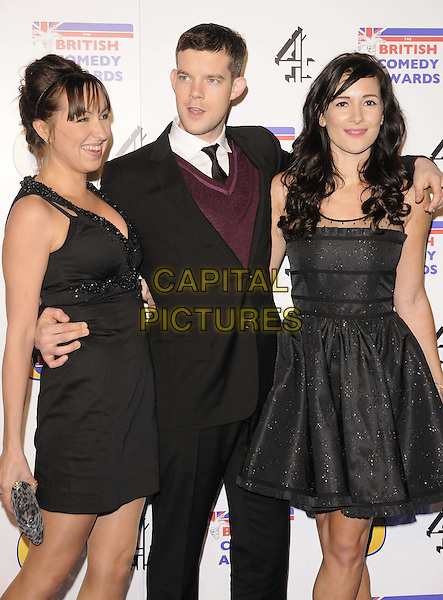 Kerry Howard, Russell Tovey & Sarah Solemani.attending the British Comedy Awards 2011, Fountain Studios, Wembley, England, UK, 16th December 2011..arrivals half length black dress arm around suit tie maroon purple jumper .CAP/CAN.©Can Nguyen/Capital Pictures.
