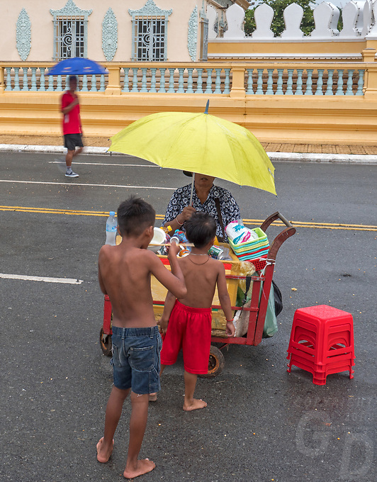 Phnom Penh street scenes and people during the Monsoon season and heavy rains. Cambodia