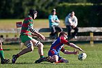 Dean Cummins has to go to ground to recover the bouncing ball ahead of Waiuku's Ronald Raaymakers. Counties Manukau Premier Club Rugby game between Waiuku & Ardmore Marist played at Waiuku on Saturday 20th June, 2009. Waiuku won the game 28 - 25.
