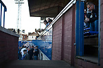 Fans in the main stand and enclosure watching the pre-match warm-up inside Palmerston Park, Dumfries before Queen of the South hosted Dundee United in a Scottish Championship fixture. The home has played at the same ground since its formation in 1919. Queens won the match 3-0 watched by a crowd of 1,531 spectators.