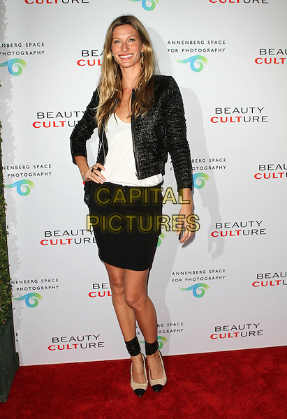 GISELE BUNDCHEN .at The opening of Beauty Culture - a photographic exploration of how feminine beauty is defined, challenged and revered in modern society held at Annenberg Space for Photography in Century City, California, USA,.May 19th 11..full length skirt top bag chanel shoes ankle strap two tone beige black jacket white hand on hip .CAP/ADM/KB.©Kevan Brooks/AdMedia/Capital Pictures.