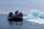 Norway, Svalbard, tourists exploring a fjord in Zodiac