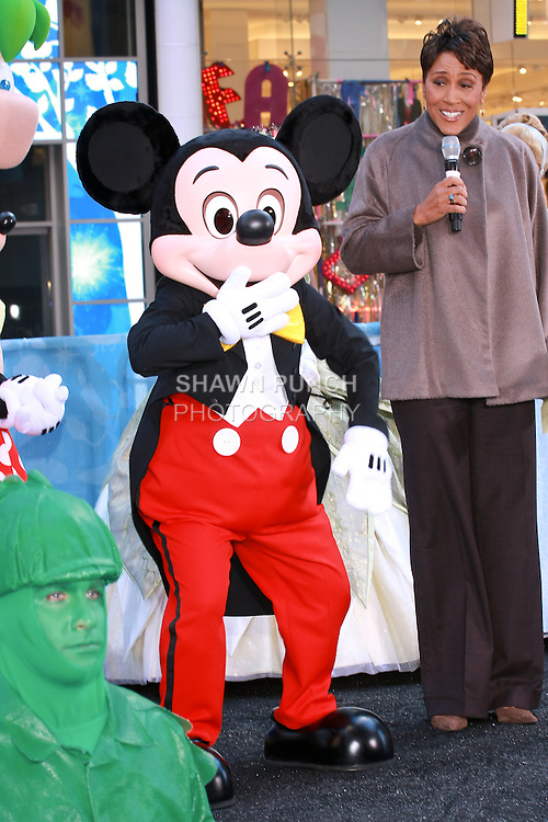 Mickey Mouse attends the Disney Store grand opening in Times Square, November 9, 2010.
