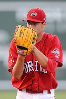 Starting pitcher Trey Ball (24) of the Greenville Drive delivers a pitch in a game against the Augusta GreenJackets on Friday, July 11, 2014, at Fluor Field at the West End in Greenville, South Carolina. Ball was a first-round pick of the Boston Red Sox (seventh overall) in the 2013 First-Year Player Draft. Greenville won, 7-6. (Tom Priddy/Four Seam Images)
