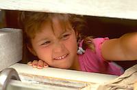 Girl age 6 reaching.  Clitherall  Minnesota USA