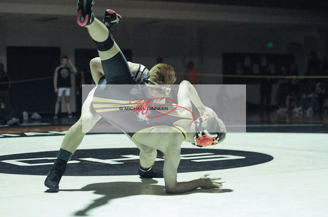 Eagle River's Grant Burningham throws Dimond's  Rylan Randolph-Oxholm  during their 138-lb. ultimate tie breaker final, won 7-6 by Randolph-Oxholm. Photo for the Star by Michael Dinneen