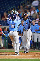Charlotte Stone Crabs third baseman Cristian Toribio (16) congratulated by Bralin Jackson (right) after hitting a home run during a game against the Clearwater Threshers on April 12, 2016 at Bright House Field in Clearwater, Florida.  Charlotte defeated Clearwater 2-1.  (Mike Janes/Four Seam Images)