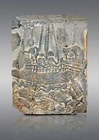Pictures & images of the North Gate Hittite sculpture stele depicting a ship with fish. 8the century BC.  Karatepe Aslantas Open-Air Museum (Karatepe-Aslantaş Açık Hava Müzesi), Osmaniye Province, Turkey. Against grey background