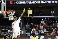 March 14, 2010. Nnemkadi Ogwumike cuts down the net after the Stanford Cardinal beat the UCLA Bruins to win the 2010 Pac-10 Tournament.