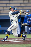 Michigan Wolverines outfielder Miles Lewis (3) follows through on his swing against the Indiana State Sycamores on April 10, 2019 in the NCAA baseball game at Ray Fisher Stadium in Ann Arbor, Michigan. Michigan defeated Indiana State 6-4. (Andrew Woolley/Four Seam Images)