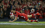 Scrum half Rhys Webb dives over to score an early try for Wales.<br /> Dove Men Series 2014<br /> Wales v Australia<br /> Millennium Stadium<br /> 08.11.14<br /> &copy;Steve Pope-SPORTINGWALES