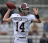 Colin Hart #14, Garden City quarterback, throws a pass during a Nassau County Conference II varsity football game against host Elmont High School on Saturday, Oct. 1, 2016. He threw for two touchdowns (62 and 69 yards) in Garden City's 49-20 win.