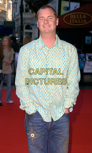 "TONY MORTIMER.The ""Just My Luck"" UK premiere at Vue West End, London, UK..June 28th, 2006.Ref: CAN.half length blue pattern white shirt hands in pockets.www.capitalpictures.com.sales@capitalpictures.com.©Capital Pictures"