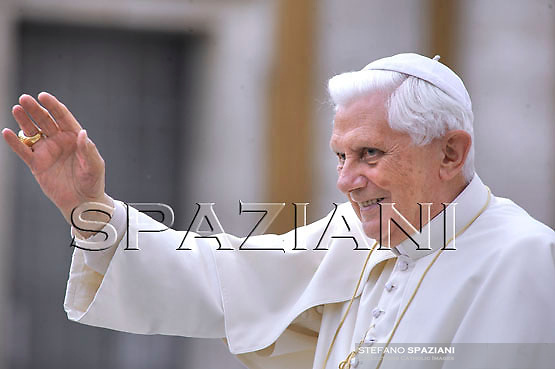 Pope Benedict XVI greets faithful during a general audience in St. Peter's Square at the Vatican, Wednesday, April 8, 2009.