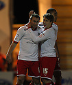 Joel Byrom of Stevenage is congratulated by Luke Freeman after scoring their sixth goal. - Colchester United v Stevenage - Weston Homes Community Stadium, Colchester - 26th December 2011  .© Kevin Coleman 2011