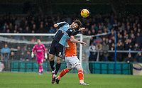 Joe Jacobson of Wycombe Wanderers wins the ball in the air during the Sky Bet League 2 match between Wycombe Wanderers and Luton Town at Adams Park, High Wycombe, England on 6 February 2016. Photo by Andy Rowland.