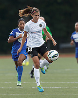 Portland Thorns FC forward Alex Morgan (13) controls the ball. In a National Women's Soccer League (NWSL) match, Portland Thorns FC (white/black) defeated Boston Breakers (blue), 2-1, at Dilboy Stadium on July 21, 2013.