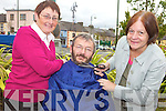 HAIR-RAISING: Jim O'Connor (centre) who will be losing his beard in an attempt to raise funds for the Abbeyfeale Community Development Project, which is under pressure due to cutbacks, with CDP staff Nora Collins and Deirdre Barrett.