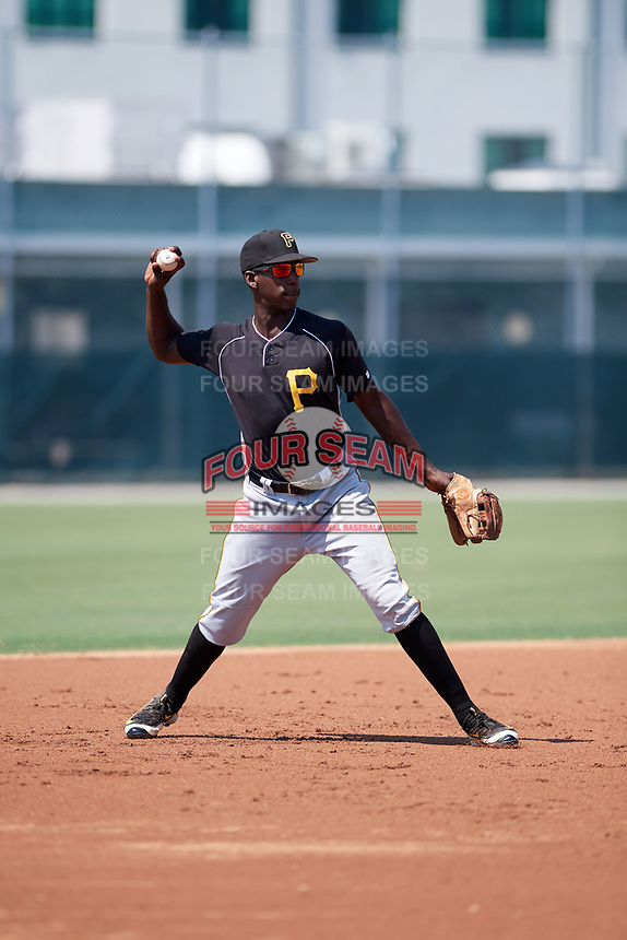 Pittsburgh Pirates third baseman Sherten Apostel (3) warmup throw to first base during an Instructional League intrasquad black and gold game on September 28, 2017 at Pirate City in Bradenton, Florida.  (Mike Janes/Four Seam Images)