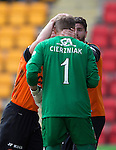 St Johnstone v Dundee United...09.05.15   SPFL<br /> Rado Cierzniak is congratulated on his penalty save by Nadi Ciftci and John Rankin<br /> Picture by Graeme Hart.<br /> Copyright Perthshire Picture Agency<br /> Tel: 01738 623350  Mobile: 07990 594431