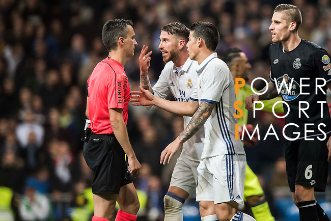 Sergio Ramos (c) and James Rodriguez of Real Madrid talk with referee Santiago Jaime Latre during the La Liga match between Real Madrid and RC Deportivo La Coruna at the Santiago Bernabeu Stadium on 10 December 2016 in Madrid, Spain. Photo by Diego Gonzalez Souto / Power Sport Images