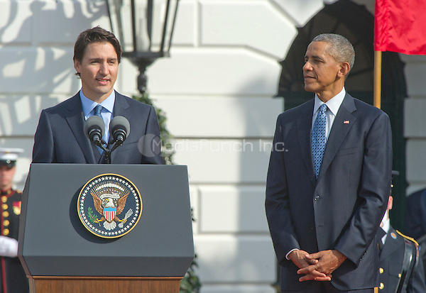 Prime Minister Justin Trudeau of Canada, left, makes remarks as United States President Barack Obama, right, listens during an Arrival Ceremony opening the Official Visit of , and Mrs. Sophie Gr&Egrave;goire Trudeau on the South Lawn of the White House in Washington, DC on Thursday, March 10, 2016. <br /> Credit: Ron Sachs / CNP/MediaPunch