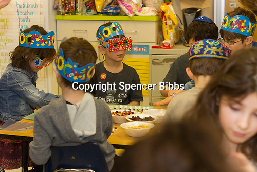 Akiba Schechter Jewish Day School kindergarten students celebrated 100 days of learning about the numbers between one and one hundred Tuesday afternoon, February 22nd, 2017 by inviting friends and family to participate in games and activities that revolve around the number 100.<br /> <br /> 0345, 0349 &ndash; Students made grids using 100 various sweets.<br /> <br /> Please 'Like' &quot;Spencer Bibbs Photography&quot; on Facebook.<br /> <br /> All rights to this photo are owned by Spencer Bibbs of Spencer Bibbs Photography and may only be used in any way shape or form, whole or in part with written permission by the owner of the photo, Spencer Bibbs.<br /> <br /> For all of your photography needs, please contact Spencer Bibbs at 773-895-4744. I can also be reached in the following ways:<br /> <br /> Website &ndash; www.spbdigitalconcepts.photoshelter.com<br /> <br /> Text - Text &ldquo;Spencer Bibbs&rdquo; to 72727<br /> <br /> Email &ndash; spencerbibbsphotography@yahoo.com