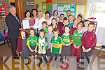GREEN FLAG: Fr Pat Moore, Mairead White (Green Schools co-ordinator), Marie Hickey, Mary Ahern and principal Carmel Fitzgerald with children from the Green School committee who raised their Green Flag at Duagh national school on Friday.