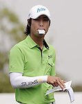 SUZHOU, CHINA - APRIL 17:  Kim Dae-hyun of Korea reads notes in his yardage book on the 2nd hole during the Round Three of the Volvo China Open on April 17, 2010 in Suzhou, China.  Photo by Victor Fraile / The Power of Sport Images