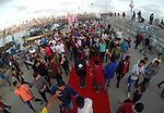 "Palestinians walk on a red carpet during the 3rd Annual Red Carpet Festival for Human Rights Films at the Gaza seaport, on May 12, 2017. The Red Carpet Festival is held in the Gaza Strip this year for the third year in a raw, amid international and Arab attention. This year, the Hash-Tag of the festival will be ""Let's go back"", which coincides with one hundred years for The Balfour Declaration, where the text of the Balfour Declaration is printed on the carpet. Photo by Mohammed Asad"