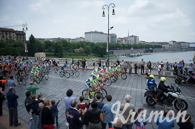 the peloton rolls out of Torino over the Po river as Giro winner Alberto Contador (ESP/Tinkoff-Saxo) and teammates line up for the obligatory photos to be taken of the winner in pink<br /> <br /> Giro d'Italia 2015<br /> final stage 21: Torino - Milano (178km)
