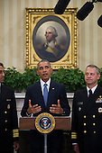 United States President Barack Obama (center) is flanked by Vice Admiral Vivek M. Murthy, United States Surgeon General (left) and Rear Admiral Boris Lushniak Officer-in-Charge of MMU Transition Between Teams (right) as he meets with members of the Public Health Service Commissioned Corps (PHS CC) after signing a citation awarding the Presidential Unit Citation to PHS CC members who participated in the Ebola containment efforts in West Africa, in the Oval Office at The White House in Washington, D.C., U.S., on Thursday, Sept. 24, 2015. <br /> Credit: Rod Lamkey Jr. / Pool via CNP